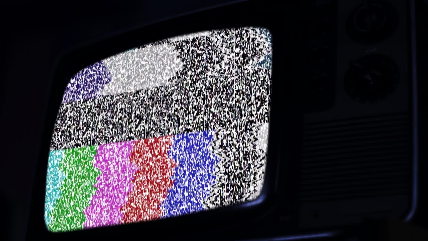 An Old 1980s Television with Noise and Color Bars on the Screen. Blue Dark Tone.  | Shutterstock HD Video #1042254802