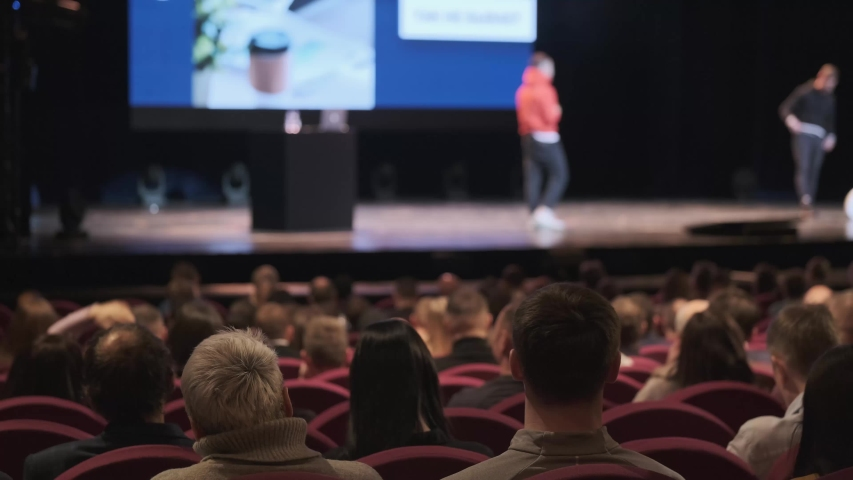 Audience listens male speakers at workshop in conference hall   Shutterstock HD Video #1042371472