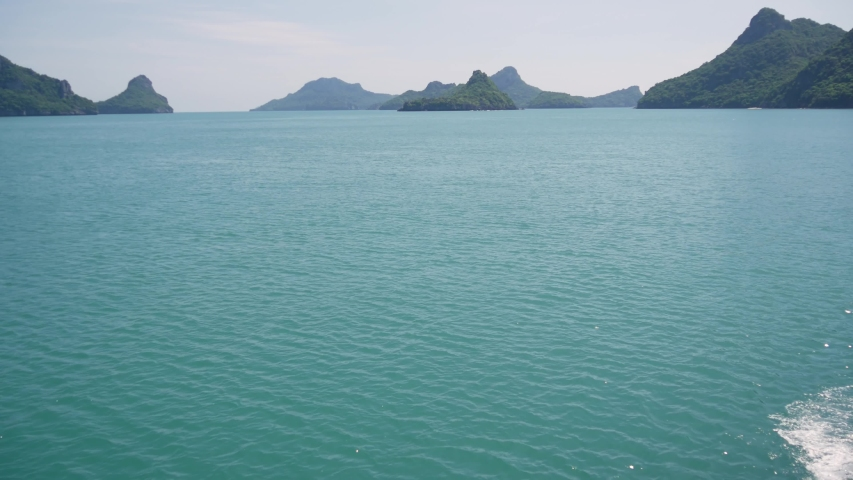 Group of Islands in ocean at Ang Thong National Marine Park near touristic Samui paradise tropical resort. Archipelago in the Gulf of Thailand. Idyllic turquoise sea natural background, copy space | Shutterstock HD Video #1042429222