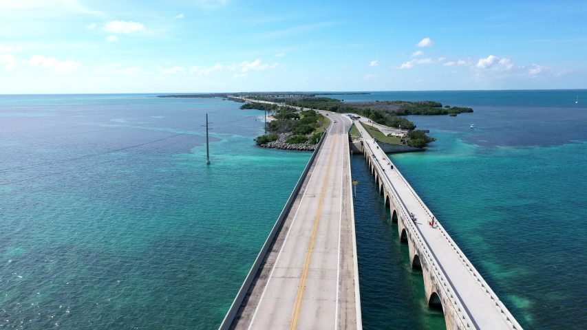 Aerial shot of the Seven Mile Bridge in Florida which connects several of the Florida Keys on the way to Key West | Shutterstock HD Video #1042489672
