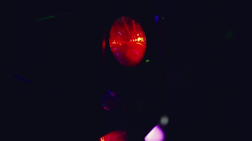 Close up slow motion shot, Blurred color party lights on a dark background inside club, pub, restaurant. Party, event, celebration concept. Abstract.   Shutterstock HD Video #1042491142