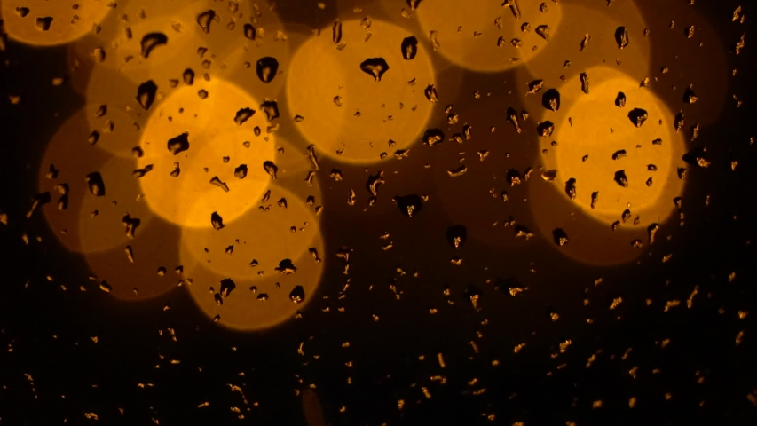 Festive yellow lamps on the christmas tree and raindrops on the window. Beautiful Blurred Abstract Background. December in Germany. | Shutterstock HD Video #1042523962