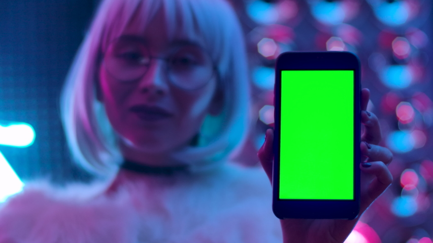 Front View Smart Phone Display for Game or Surfing or App. Greenscreen Vertical Mockup Keying for Tracking or Presentation Advertising Video Content or News Blog. Girl Closeup Holding Phone ChromaKey | Shutterstock HD Video #1042689832