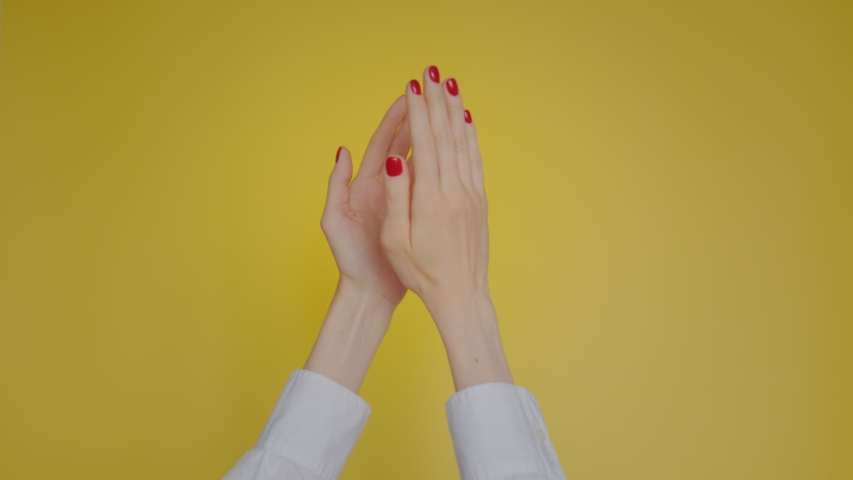Woman hands clapping applause gesture isolated over yellow background in studio. Copy space for advertisement. With place for text or image. Advertising area, mock up.haughty applause | Shutterstock HD Video #1042727602