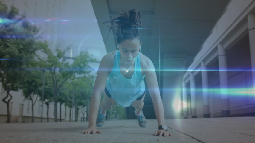 Animation of data processing and network of connections with a young woman doing crunches in an urban park in the background | Shutterstock HD Video #1042798972