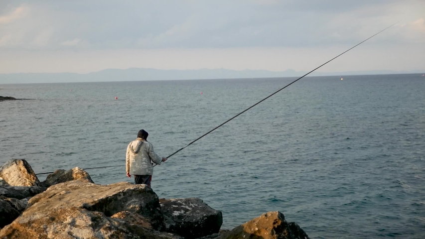 Fisherman fishes in the sea | Shutterstock HD Video #1042800112
