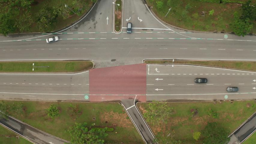Top down aerial view of an urban road in Cyberjaya City, Malaysia. | Shutterstock HD Video #1042802692