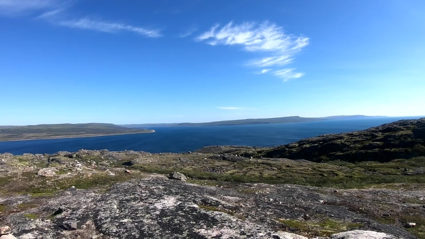 Cairn on the background of the Barents Sea | Shutterstock HD Video #1043122762