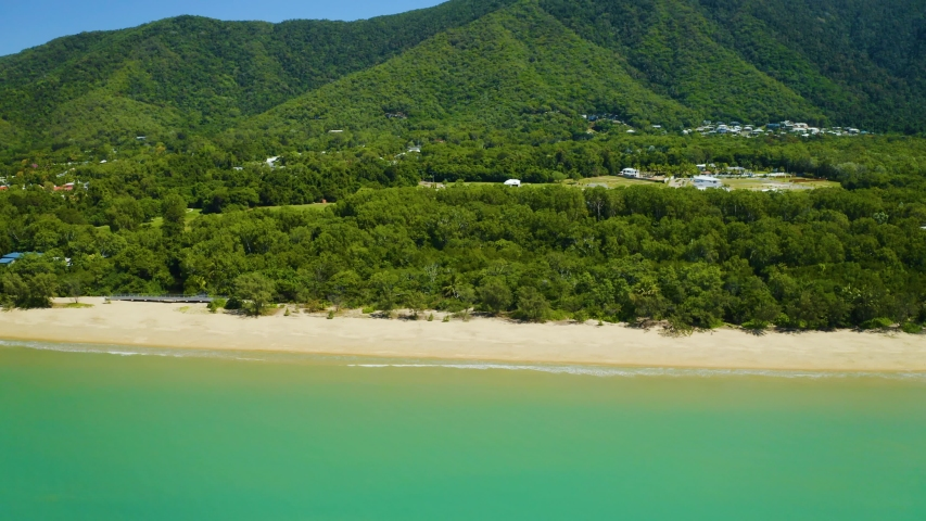 Aerial, beautiful view on huge sand beach and a coastline in Palm Cove, Cairns in Queensland, Australia | Shutterstock HD Video #1044094102