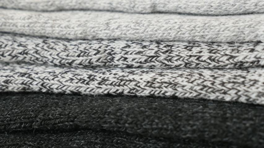Socks made of wool in different colors slow tilt 4K video | Shutterstock HD Video #1044189652
