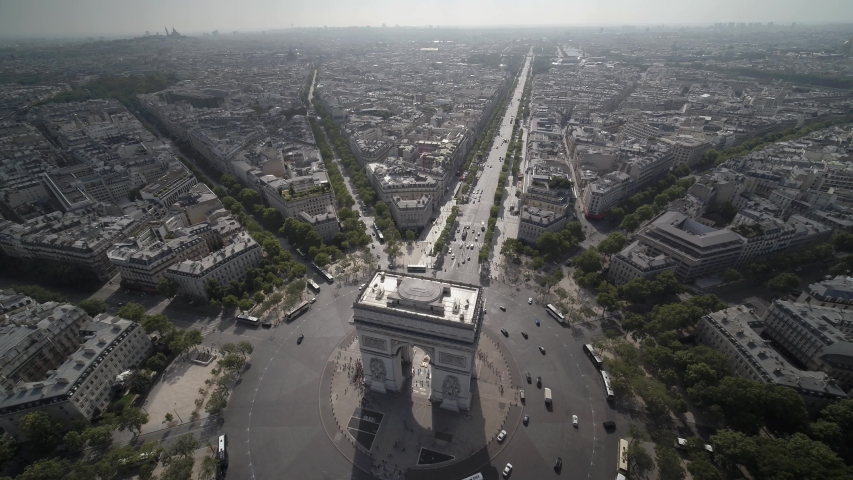 Aerial drone shot of the Arc de Triomphe and the Place de l'Etoile in Paris in Summer. | Shutterstock HD Video #1044578272