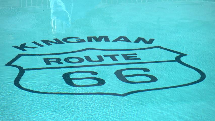 Legendary kingman route 66 headline in the swimming pool in 4k   Shutterstock HD Video #1044581452