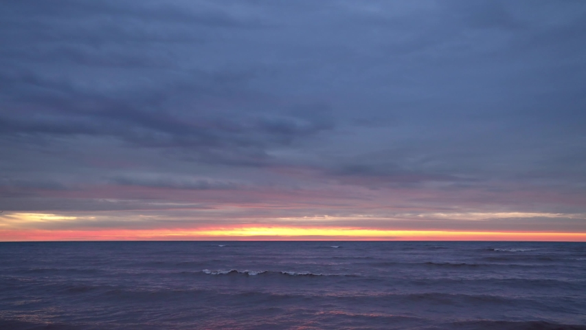 Fiery time lapse twilight and sunrise over Lake Michigan, makes a fantastic background for anything.