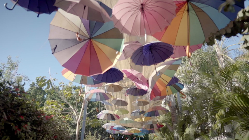 POV walk along street with a floating canopy of colorful umbrellas | Shutterstock HD Video #1044687712