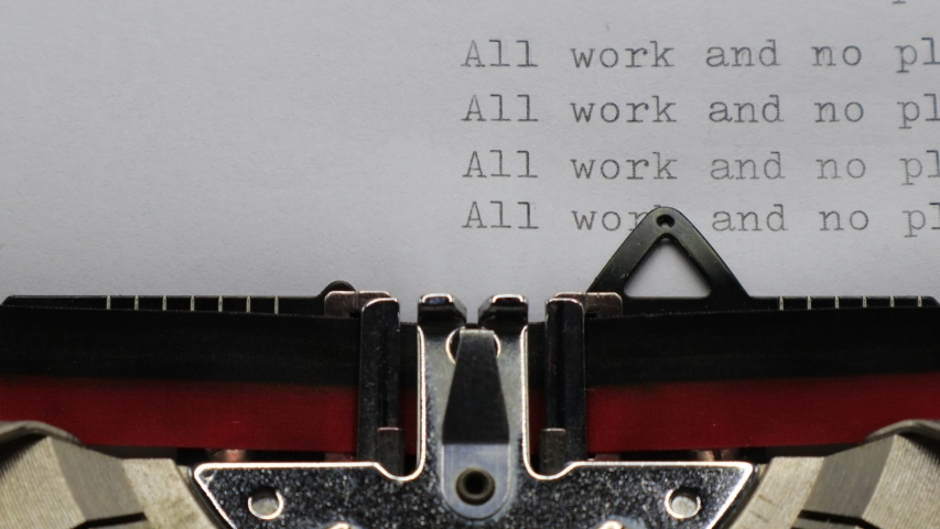Typing ALL WORK AND NO PLAY MAKES JACK A DULL BOY with an old vintage Typewriter   Shutterstock HD Video #1044784132