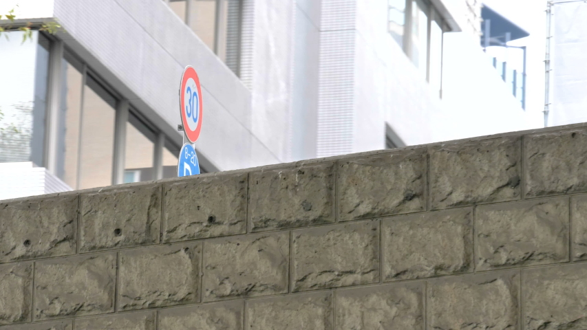The number 30 signage on the side of the wall in Tokyo Japan while moving so fast on the river boat | Shutterstock HD Video #1044891322