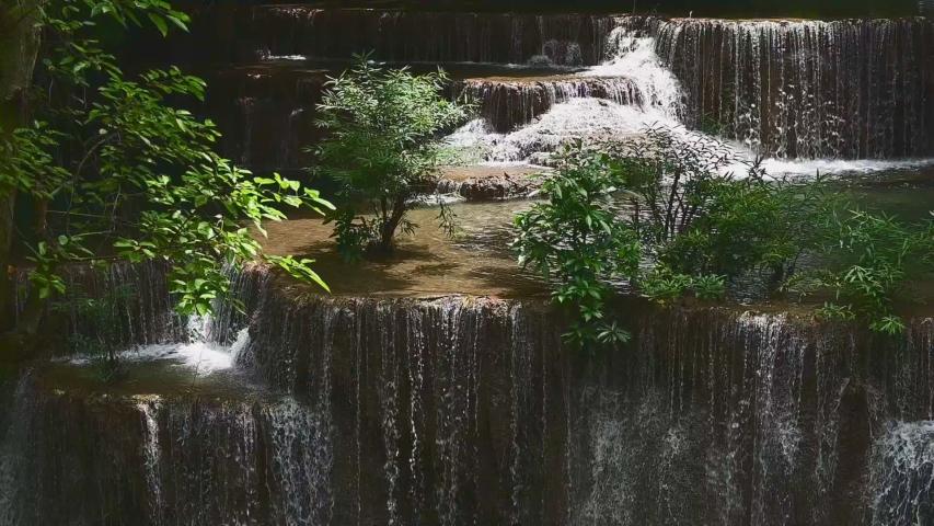 Slow motion. Beautiful waterfall is name Hua mae kamin waterfall in Erawan National Park, Kanchanaburi province, Thailand.
