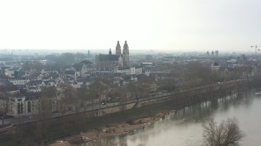 France, Tours city, drone aerial view above Loire river with Saint-Gatien cathedral in the background. | Shutterstock HD Video #1045192492