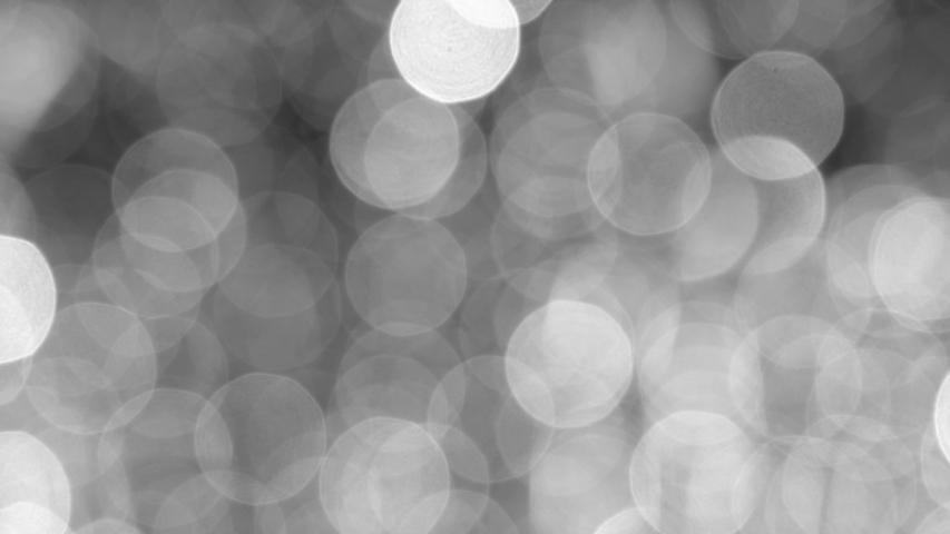 Beautiful black and white shiny round bokeh 4k video abstract background.   Shutterstock HD Video #1045202692
