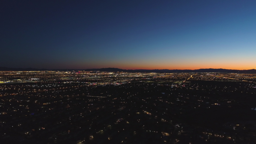 Las Vegas Skyline at Sunrise. Morning Twilight. Mountains on Background. Nevada, USA. Aerial View. Drone Flies Sideways | Shutterstock HD Video #1045262722