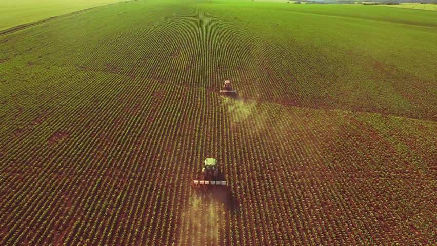Agriculture Aerial Of Tractor Spraying Farm Land With Pesticides Farming Equipment Food Modification Crop Farming Concept | Shutterstock HD Video #10461839