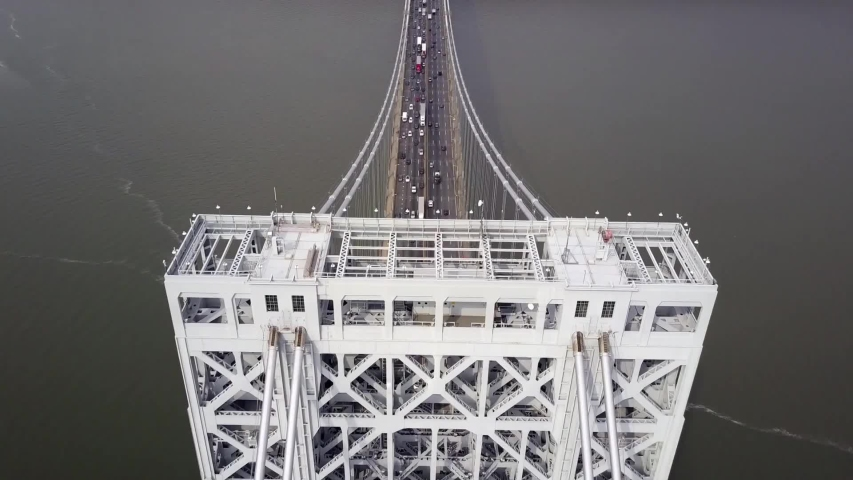 New Jersey /  United States    , Aerial video from  George Washington Bridge , Suspension bridge in Fort Lee ,    taken by drone camera from above | Shutterstock HD Video #1046440462