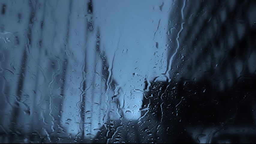Close up shot of rain falling on window in new york, usa | Shutterstock HD Video #1046485252