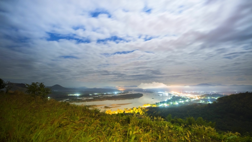 Khong River under cloudy sky acorss mountain separated Thai and Laos country location at north east of thailand | Shutterstock HD Video #1046615272