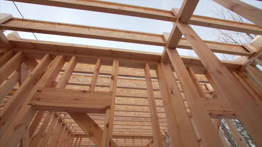 View from below of beams and trussings of a framed house under construction   Shutterstock HD Video #1046725672