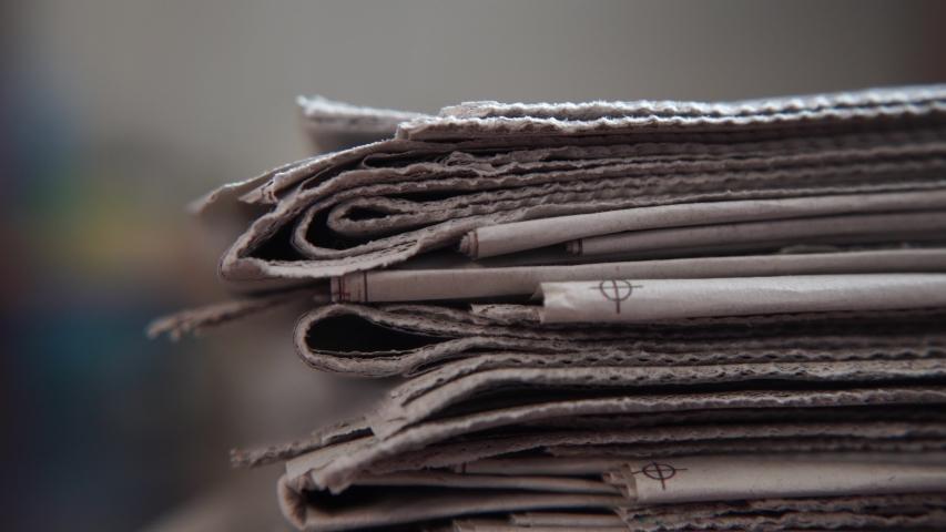 Close-up shot of Newspaper stack | Shutterstock HD Video #1046817652