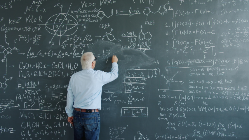 Mature man physicist writing formulas on blackboard with chalk indoors at school busy with solving scientific problem. Science, occupation and education concept. | Shutterstock HD Video #1046982802