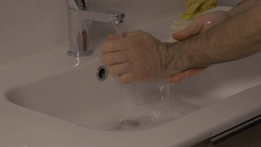Hand hygiene on white surface, disinfectant soap foam rinse | Shutterstock HD Video #1047330112