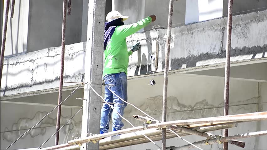 12 June 2015 Putting A Coat Of Cement On Wall Professional Masonry Working  On A New House Outside Wall With Adding Coat Of Rough Cement With Masonry  Tools ...