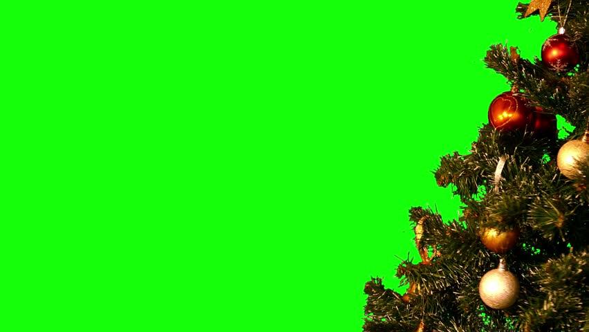 Christmas tree with Christmas-tree decorations rotating on green screen (medium shot, loop, 4k)
