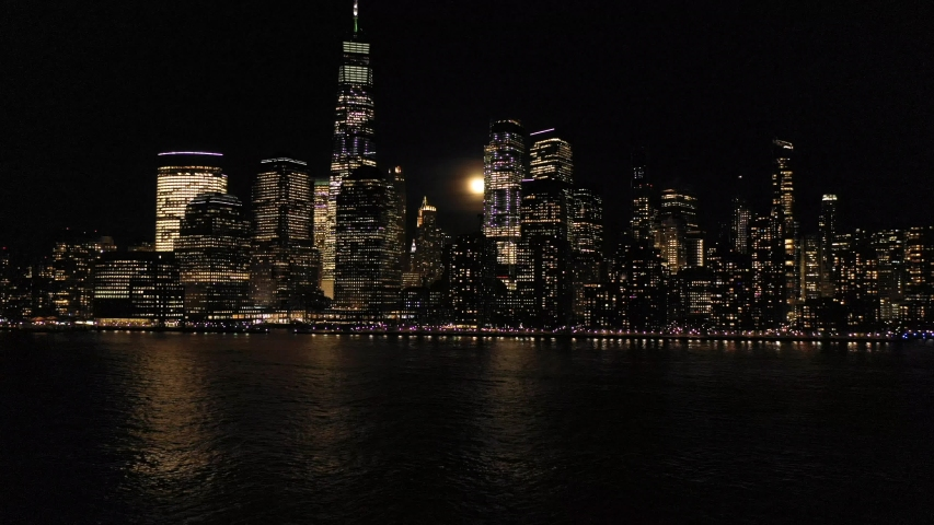 4K Aerial Footage, View from the Hudson River to the Lower Manhattan lit by lights at night. Shot in NY, USA. | Shutterstock HD Video #1048841002