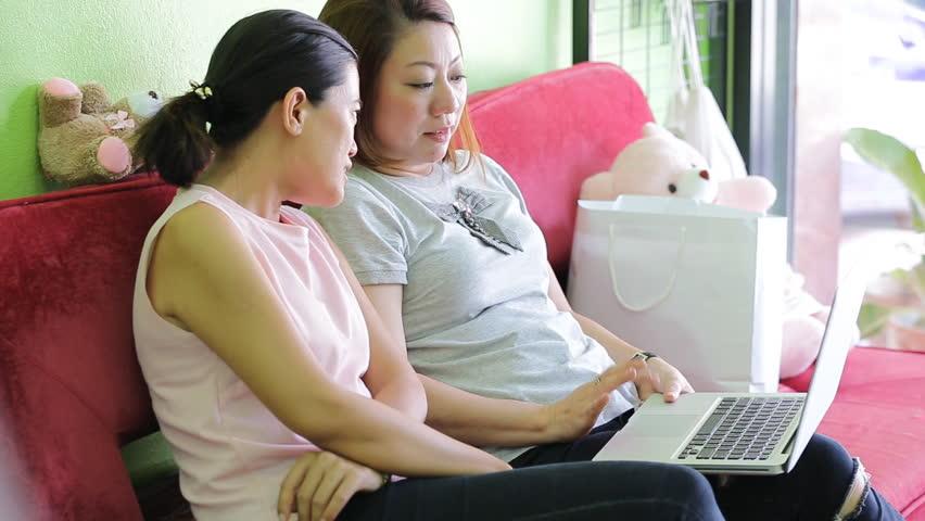 Asian woman using laptop in office   Shutterstock HD Video #10491440