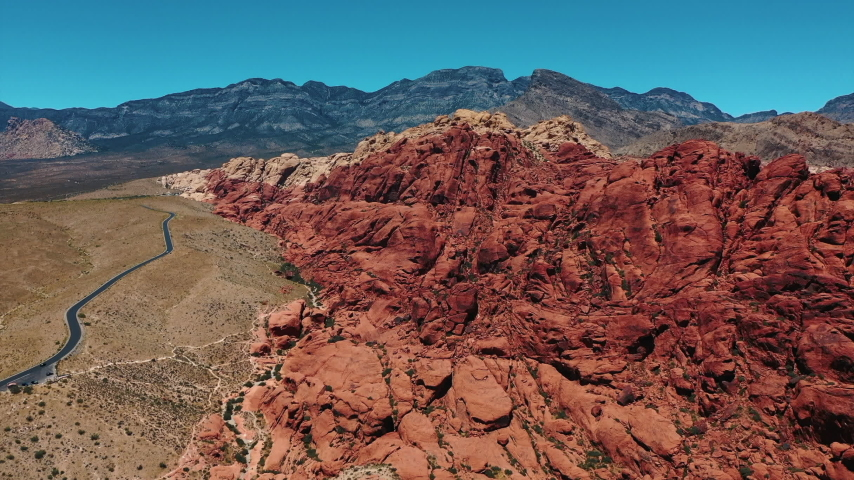 Stunning aerial landscape views of Red Rock Canyon in in Nevada's Mojave Desert near Las Vegas. | Shutterstock HD Video #1049465512