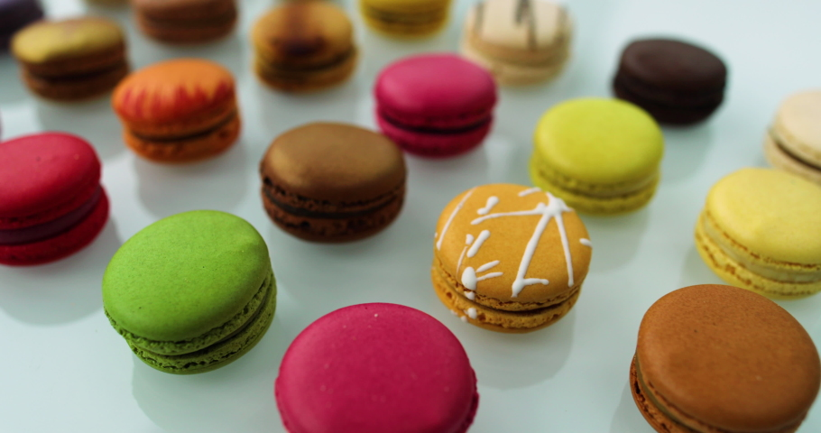 Macarons dessert. Many cute colors Assortment of pastel colored macaron of different flavors. | Shutterstock HD Video #1049488252