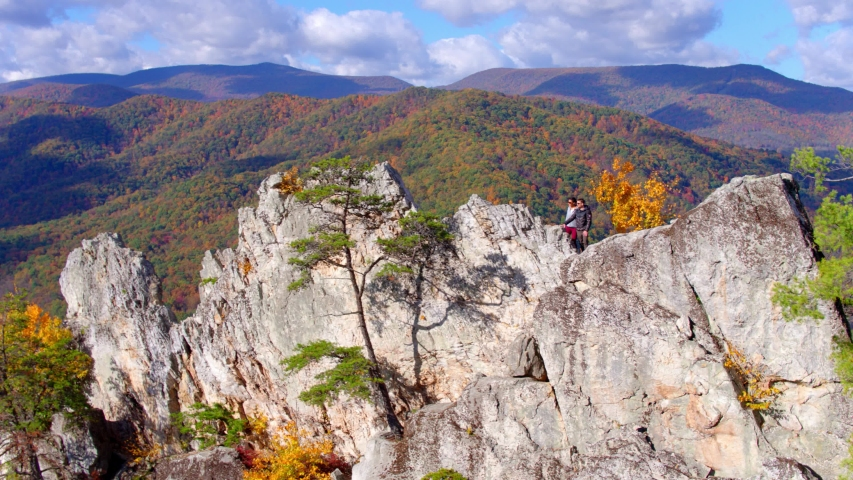 Couple Hiking at Top of Seneca Rocks Peak, West Virginia, Aerial View | Shutterstock HD Video #1049616502
