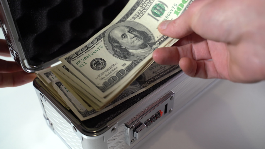 Open a metal suitcase with dollar bills. Close-up | Shutterstock HD Video #1049640832