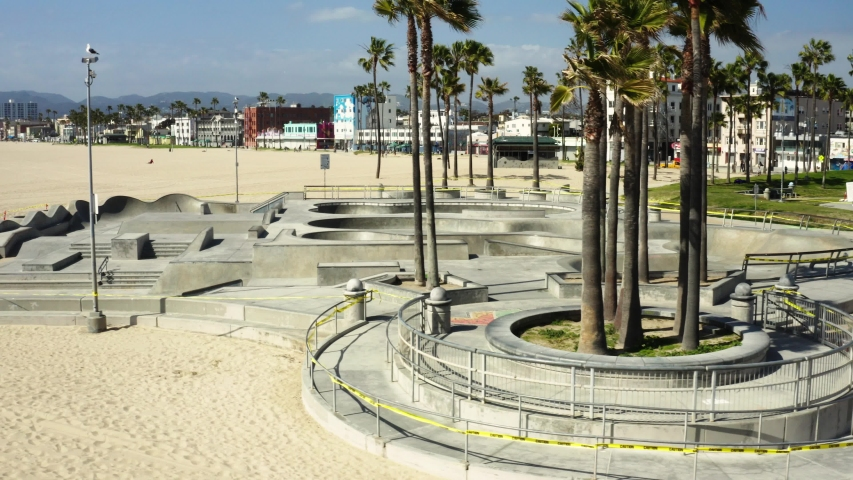 Quarantine in Los Angeles, aerial shot of empty skatepark in Venice beach, pandemic situation, deserted city | Shutterstock HD Video #1049870962