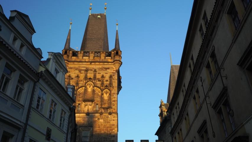 Lesser town bridge tower is entrance to Charles bridge in Prague, Czechia. Malostranská věž - Tilt down 4K. Culture and history from Czech republic. | Shutterstock HD Video #1050036742