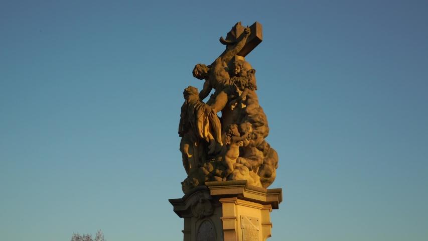 Statues of saint on Charles bridge in Prague. Saint Luistgarda . Czech history and culture. | Shutterstock HD Video #1050036772