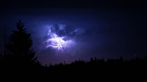 stormy sky with flashes of lightning in the forest