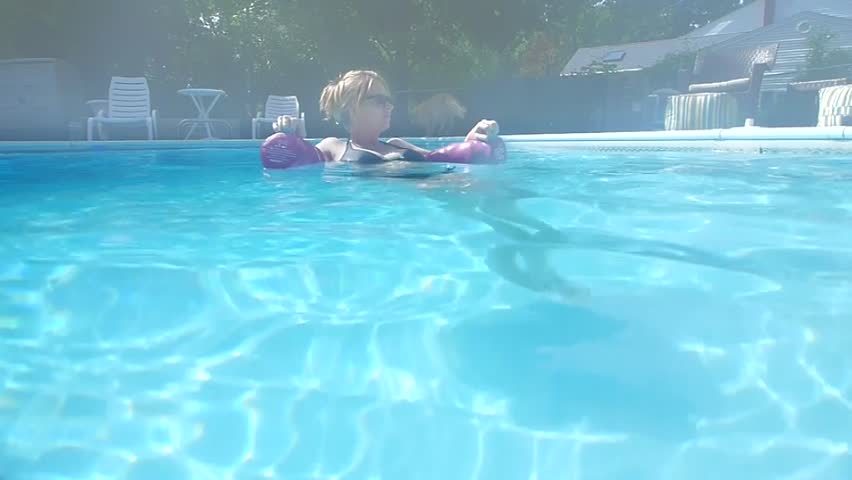 Underwater Video Of Young Pregnant Woman Swimming And Floating In A Pool Stock Footage Video