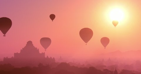 Myanmar Bagan at sunset with flying air balloons over ancient Dhammayangyi Temple. Beautiful travel background of rural Burma