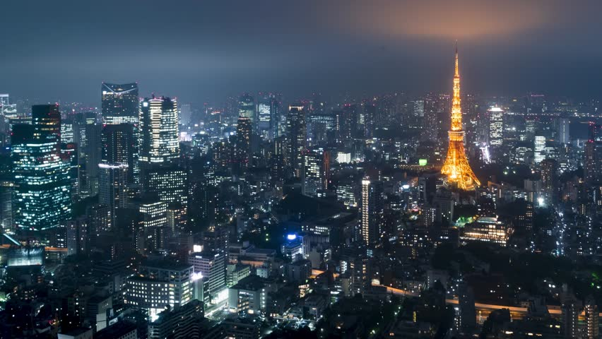 Time-lapse of Tokyo from above with Tokyo Tower in the background.   Shutterstock HD Video #10536692