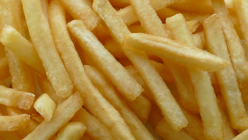 French fries background, closeup shot | Shutterstock HD Video #10561829