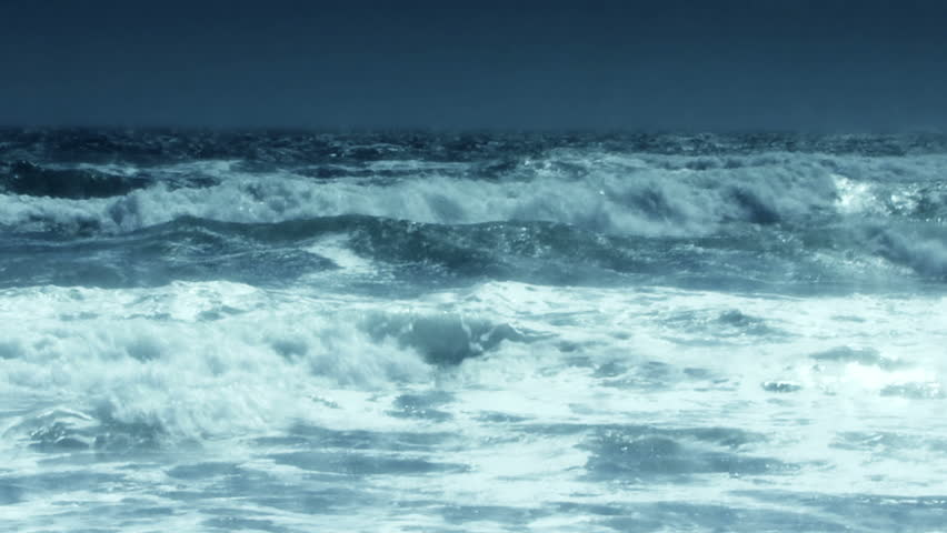 Oceanic 0309: Slow motion blue waves roll into shore. | Shutterstock HD Video #10575182