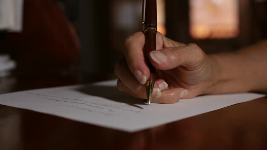 Woman writing in guest book stock footage video 3324233 shutterstock a woman writing a letter by hand snail mail hd stock footage clip thecheapjerseys Images